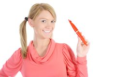 Beautiful woman with a pen in hand Stock Image