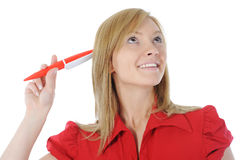 Beautiful woman with a pen in hand Stock Photo