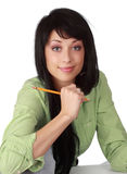 Beautiful woman with pencil Stock Image