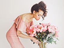 Beautiful woman with peonies Royalty Free Stock Photos