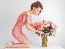 Beautiful woman with peonies Royalty Free Stock Photo