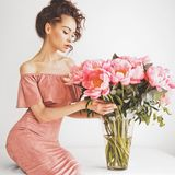 Beautiful woman with peonies Stock Image
