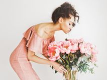 Beautiful woman with peonies Royalty Free Stock Image