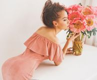 Beautiful woman with peonies Royalty Free Stock Images