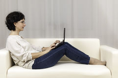 Beautiful woman people working laptop sofa Stock Photos