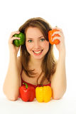 Beautiful woman with peppers Royalty Free Stock Photos