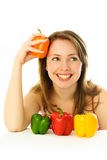 Beautiful woman with peppers Stock Photo