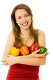 Beautiful woman with peppers Royalty Free Stock Images