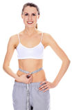 Beautiful woman with perfect body measuring waist Royalty Free Stock Photos