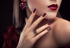 Beautiful woman with perfect make-up and manicure wearing jewellery Stock Photography