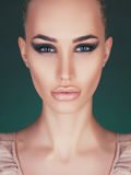 Beautiful woman with perfect make-up Stock Photography