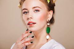 Beautiful woman with perfect makeup wearing earrings Royalty Free Stock Photo