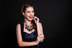 Beautiful woman with perfect makeup wearing jewelry Stock Photography