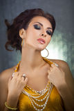 Beautiful woman with perfect makeup wearing jewelry Royalty Free Stock Images