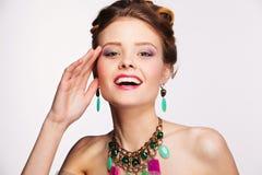 Beautiful woman with perfect makeup wearing jewelry. on white Stock Photo