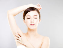 Beautiful woman with perfect skin and armpit`s care Stock Photo