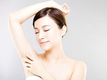 Beautiful woman with perfect skin and armpit`s care Royalty Free Stock Photography