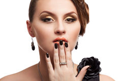 Beautiful woman with perfect skin and black nails Royalty Free Stock Images