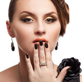 Beautiful woman with perfect skin and black nails Royalty Free Stock Photography