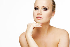 Beautiful woman with perfect skin and blond hair. Royalty Free Stock Image