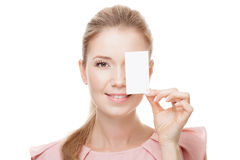 Beautiful woman with perfect skin holding empty blank card Stock Photography