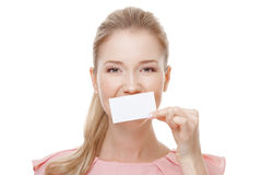Beautiful woman with perfect skin holding empty blank card Royalty Free Stock Photography
