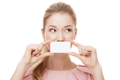 Beautiful woman with perfect skin holding empty blank card Royalty Free Stock Images