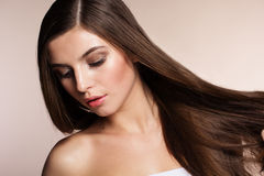Beautiful woman with perfect skin and long hair Stock Images