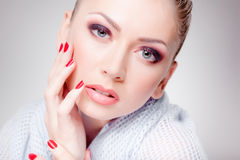 Beautiful woman with perfect skin wearing make-up. Studio Stock Photo