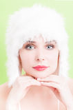 Beautiful woman with perfect skin wearing a white fur hat Royalty Free Stock Photography