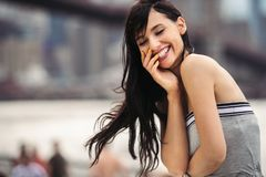 Beautiful woman with perfect smile laughing on city street in New York. Stock Photography