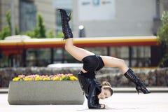 Beautiful woman performing acrobatics Stock Photo