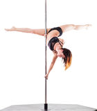 Beautiful woman performing pole dance. Studio shot, on white background, isolated. Cut Stock Photos