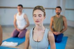 Beautiful woman performing yoga Stock Photo