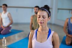 Beautiful woman performing yoga Stock Images