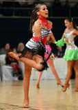 Beautiful woman performs during dancesport competition Stock Photo