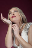 Beautiful woman with perl beads royalty free stock photos