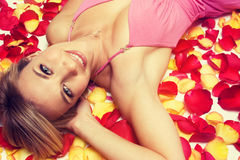 Beautiful Woman in Petals Royalty Free Stock Images