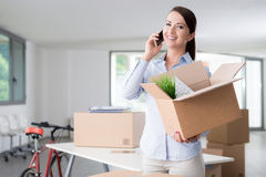 Beautiful woman on the phone with an open box Royalty Free Stock Photo