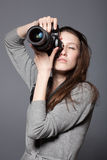 Beautiful woman photographer with camera Stock Image