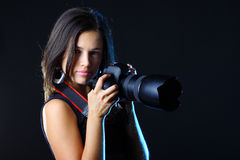 Beautiful woman photographer with camera Royalty Free Stock Photos
