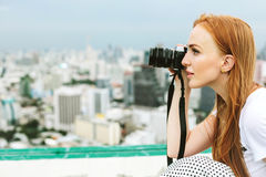 Beautiful woman photographer outdoors Stock Photo