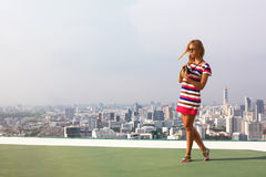 Beautiful woman photographer on the roof top Stock Photography