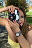 Beautiful woman photographing summer park Stock Image