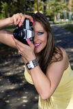 Beautiful woman photographing summer park Royalty Free Stock Images