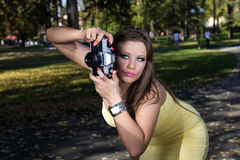 Beautiful woman photographing summer park Royalty Free Stock Photo