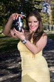 Beautiful woman photographing summer park Royalty Free Stock Photography