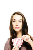 Beautiful woman picking poker card Stock Photo
