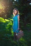 Beautiful woman with picnic basket and bottle of wine in evening Royalty Free Stock Images