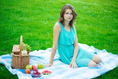 Beautiful woman with picnic basket in summer park Royalty Free Stock Photography